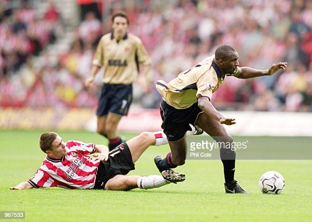 Patrick Vieira of Arsenal is brought down by Marian Pahars of Southampton during the FA Barclaycard Premiership match played at St Mary's in...