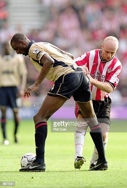 Patrick Vieira of Arsenal is tackled by Chris Marsden of Southampton during the FA Barclaycard Premiership match played at St Mary's in Southampton...