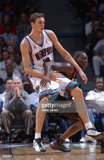 Pau Gasol of the Memphis Grizzlies tries to gain position against Zach Randolph of the Portland Trail Blazers during their preseason game against the...
