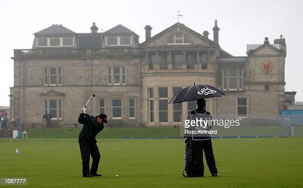 Paul Lawrie of Scotland plays his second shot to the 18th green as he completes his rain delayed third round during the fourth day of the inaugural...