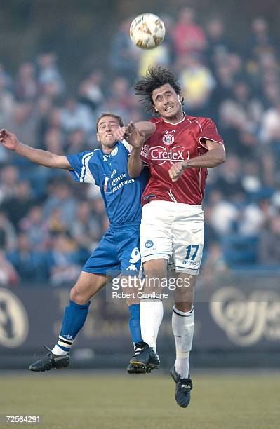 Paul Trimboli of South Melbourne is challenged by Paul Bilokapic of Sydney United during the round 3 NSL match between South melbourne and Sydney...