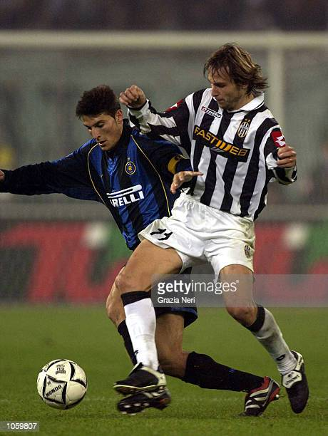 Pavel Nedved of Juventus and Javier Zanetti of Inter Milan in action during the Serie A 9th Round League match between Juventus and Inter Milan...