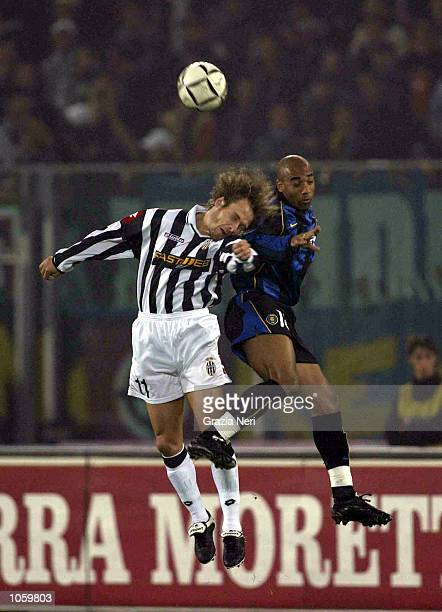 Pavel Nedved of Juventus and Stephane Dalmat of Inter Milan in action during the Serie A 9th Round League match between Juventus and Inter Milan...