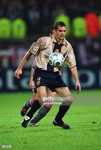 Phillip Cocu of Barcelona in action during the UEFA Champions League match against Olympic Lyonnais played at the Stade de Gerland in Lyon France...