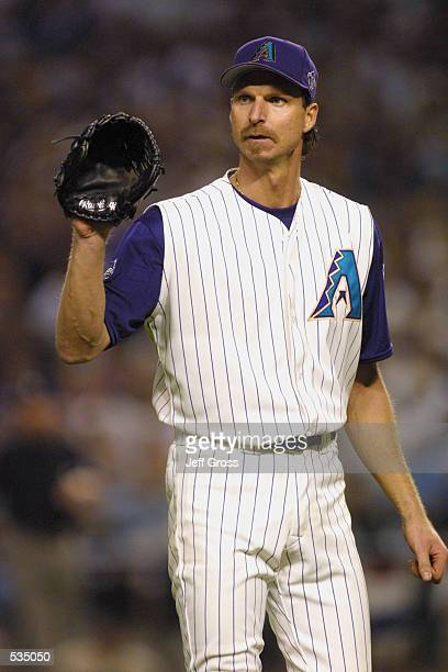 Pitcher Randy Johnson of the Arizona Diamondbacks waits for the ball during game 2 of the World Series against the New York Yankees at Bank One...