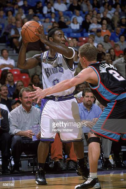 Point guard Mateen Cleaves of the Sacramento Kings looks to make a pass during the pre-season game against the Memphis Grizzlies at Arco Arena in...