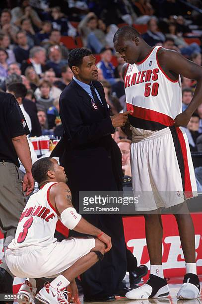 Portland Trailblazers forward Zach Randolph and point guard Damon Stoudamire get instruction from head coach Maurice Cheeks during the preseason game...