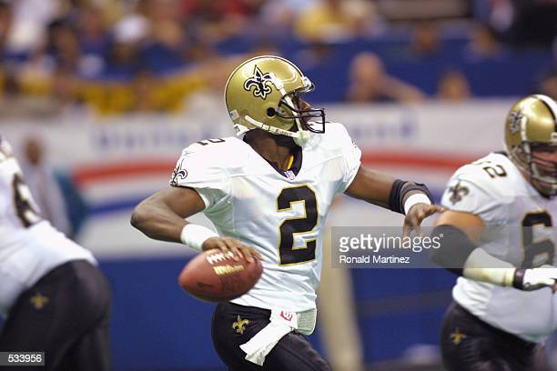 Quarterback Aaron Brooks of the New Orleans Saints looks to pass against the Minnesota Vikings at the Superdome in New Orleans Louisiana The Saints...