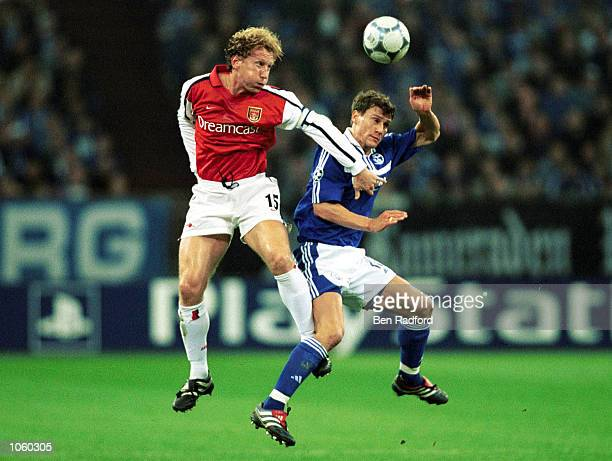 Ray Parlour of Arsenal beats Ebbe Sand of Schalke in the air during the UEFA Champions League First Stage Group C match between FC Schalke 04 and...