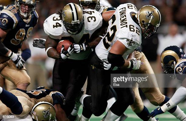 Ricky Williams of the New Orleans Saints breaks through the defense of the StLouis Rams of the during the game at the Dome at the America's Center in...