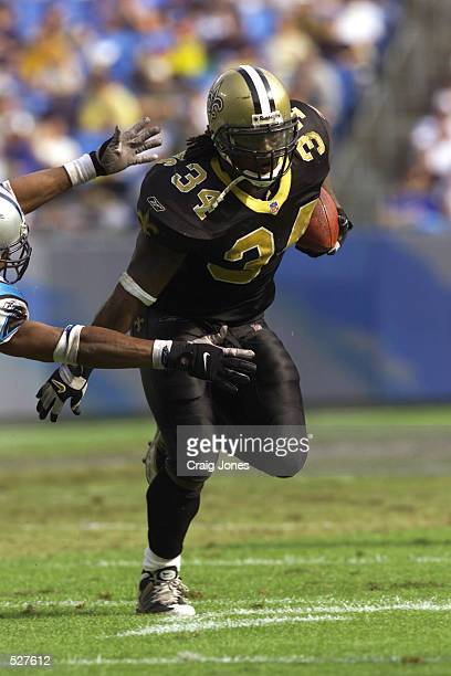Ricky Williams of the New Orleans Saints runs with the ball against the Carolina Panthers during the game at Ericsson Stadium in Charlotte North...