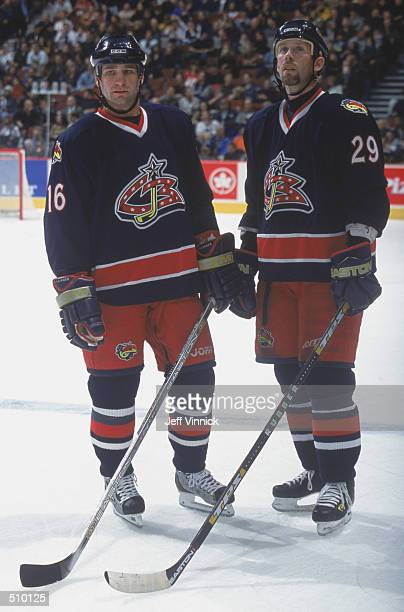 Right wing Grant Marshall and teammate center Mike Sillinger of the Columbus Blue Jackets stand together during a break in play against the Vancouver...