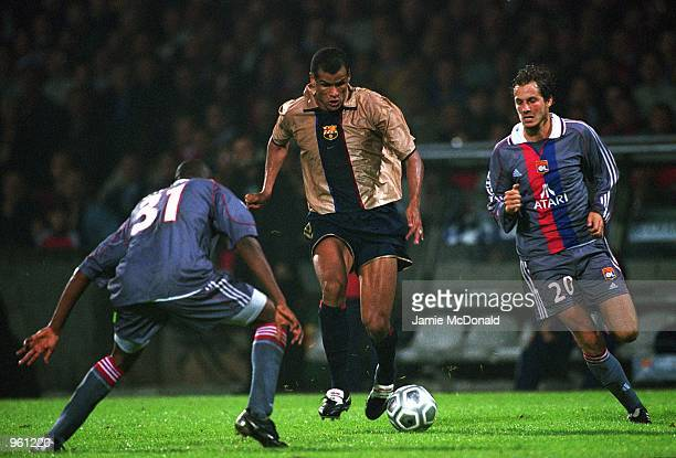 Rivaldo of Barcelona takes on Claudio Cacapa of Lyon during the UEFA Champions League match between Olympic Lyonnais and Barcelona played at the...
