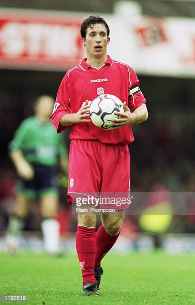Robbie Fowler of Liverpool walks off with the match ball after scoring a hat-trick in the FA Barclaycard Premiership match against Leicester City...