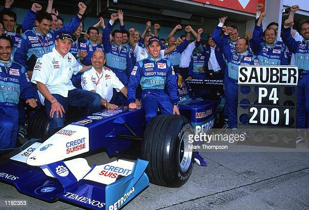 Sauber drivers Nick Heidfeld and Kimi Raikkonen celebrate 4th place in the Constructors Championship with Boss Peter Sauber after the Formula One...