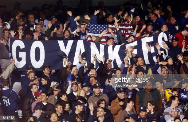 Spectators watch the New York Yankees play the Arizona Diamondbacks during game four of the Major League Baseball World Series at Yankee Stadium in...