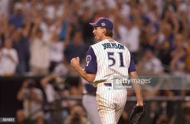 Starting pitcher Randy Johnson of the Arizona Diamondbacks celebrates a strike out against the New York Yankees during game two of the Major League...