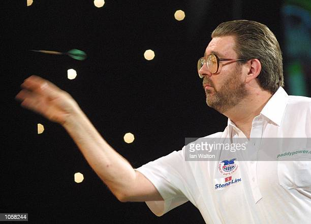 Steve Brown of USA in action against Alex Roy of England during the first round game in the Professional Darts Corporation and Paddy Power World...