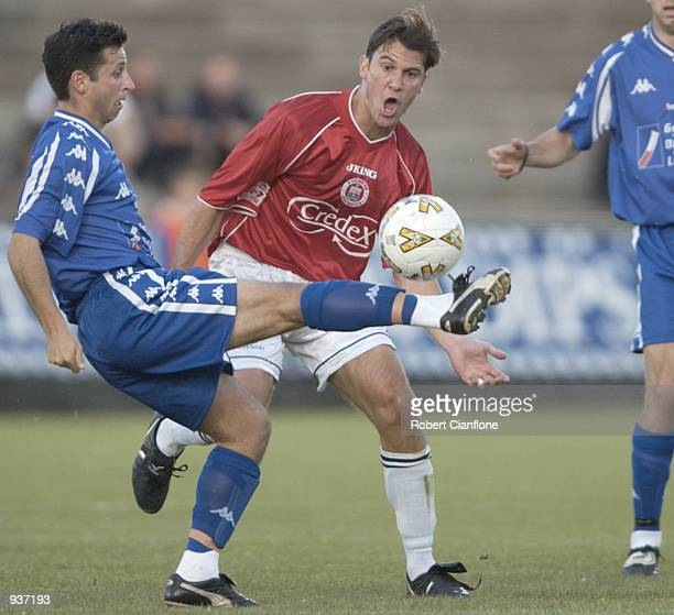 Steve Panopoulos#7 of South Melbourne is challenged by Zlatko Arambasic of Sydney United during the round 3 NSL match between South melbourne and...