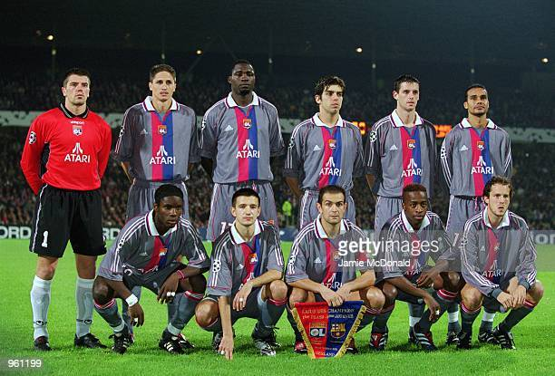 The Lyon team line up prior to the UEFA Champions League match against Barcelona played at the Stade de Gerland in Lyon France Barcelona won the...