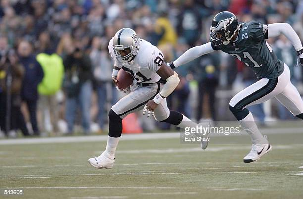 Tim Brown of the Oakland Raiders runs against the defense Bobby Taylor of the Philadelphia Eagles during the game at Veterans Stadium in Philadelphia...