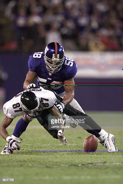 Todd Pinkston of the Philadelphia Eagles is hit from behind by Mike Barrow of the New York Giants during the second half of the game at Giants...
