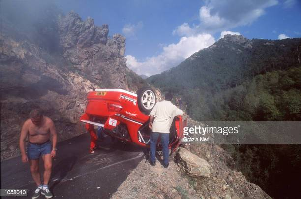Tommi Makinen's car lies on the edge of the road follwoing a crash during the Rally of Corsica a part of the World Rally Championship DIGITAL IMAGE...
