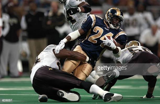 Trung Candidate of the StLouis Rams breaks past the defense of the New Orleans Saints during the game at the Dome at the America's Center in StLouis...