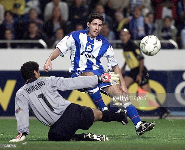 Victor of Deportivo La Coruna and Bonano of Barcelona in action during the Spanish Primera Liga match played between Deportivo La Coruna and...