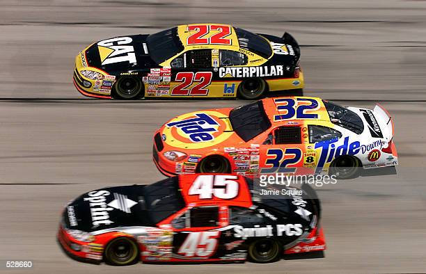 Ward Burton driver of the Caterpillar Dodge Intrepid R/T practices for Sunday's EA Sports 500 alongside Kyle Petty in his Petty Enterprises Dodge...