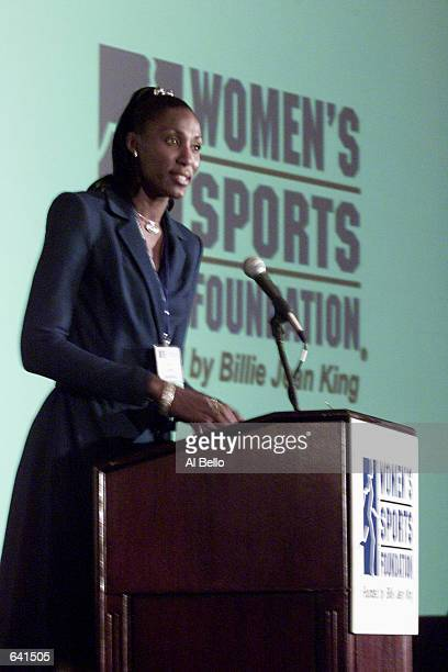 WNBA star Lisa Leslie accepts her award as Sportswoman of the Year in the team sports category during a ceremony for the Women's Sports Foundation at...