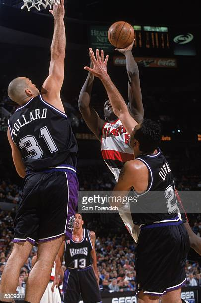 Zach Randolph of the Portland Trail Blazers hooks the ball into the hoop during the preseason game against the Sacramento Kings at the Rose Garden in...