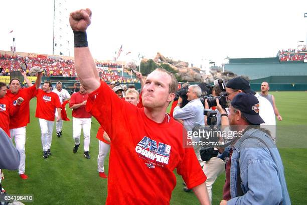 Anaheim Angels outfielder Darin Erstad celebrates on the filed after the Angels defeated the Minnesota Twins 13 to 5 in game five of the American...