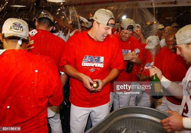 Anaheim Angels rookie pitcher John Lackey celebrates in the clubhouse after the Angels defeated the Minnesota Twins 13 to 5 in game five of the...