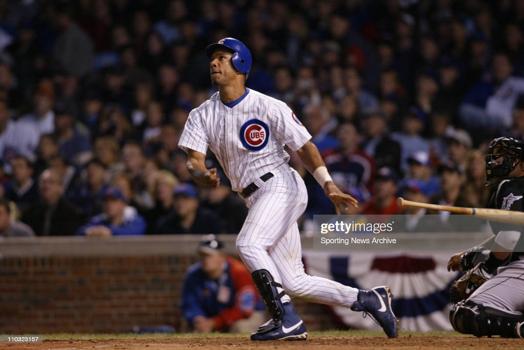 15 Oct 2003: Moises Alou of the Chicago Cubs watches the flight of the ball after hitting a home run during the Cubs 9-6 loss to the Florida Marlins in game 7 of the NLCS at Wrigley Field in Chicago, IL. : ニュース写真