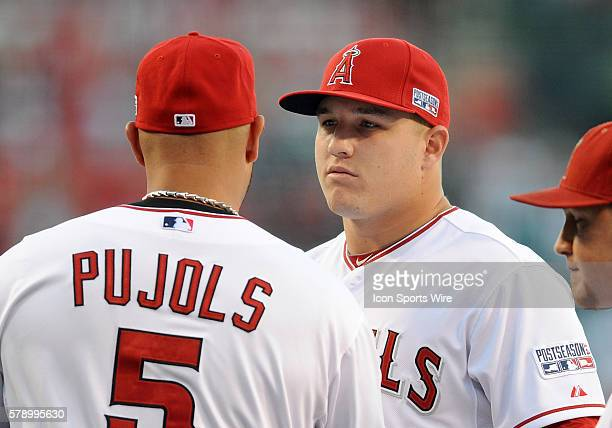 Los Angeles Angels of Anaheim Mike Trout hugs Albert Pujols during player introductions before ALDS game one against the Kansas City Royals played at...