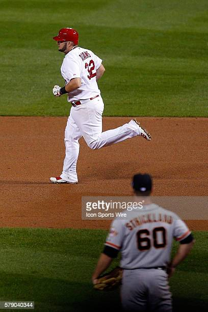 St. Louis Cardinals' Matt Adams rounds the bases after hitting a solo home run off San Francisco Giants relief pitcher Hunter Strickland during the...