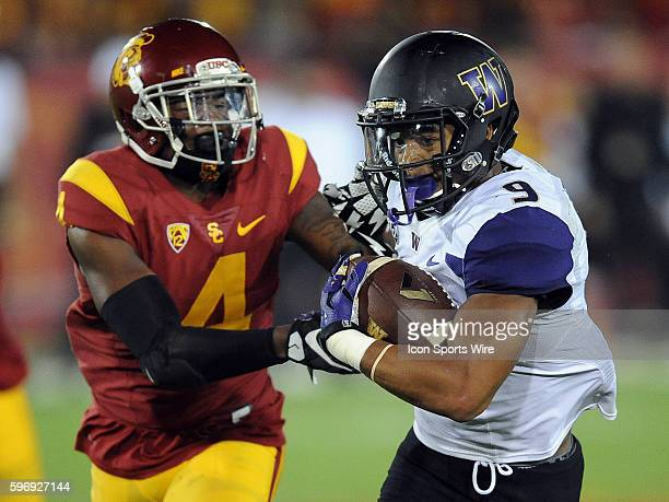 USC Trojans free safety Chris Hawkins tries to bring down Washington Huskies tailback Myles Gaskin during a game played at the Los Angeles Memorial...