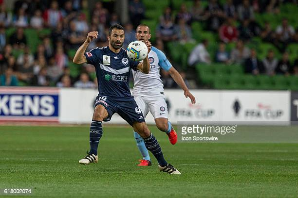 Fahid Ben Khalfallah of Melbourne Victory controls the ball in front of Manny Muscat of Melbourne City during the Semifinal of the 2016 FFA Cup...