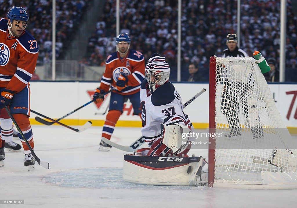 Jets Connor Hellebuyck (37) makes a save during the Winnipeg Jets vs Edmonton Oilers game at the Investors Group Field in Winnipeg MB.