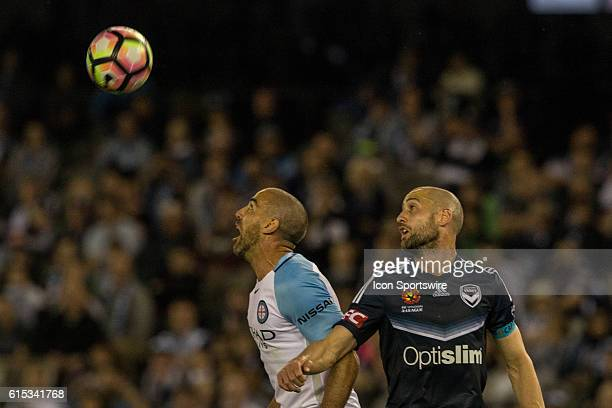 Manny Muscat of Melbourne City and Carl Valeri of Melbourne Victory watch as the ball passes them both during the 2nd Round of the 201617 ALeague...
