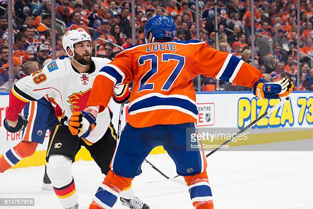 Milan Lucic of the Edmonton Oilers fights Deryk Engelland of the Calgary Flames during the Calgary Flames versus the Edmonton Oilers hockey game in...