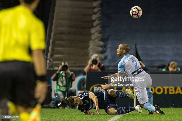 Mitch Austin of Melbourne Victory and Manny Muscat of Melbourne City contest the ball during the 2nd Round of the 201617 ALeague Season between...