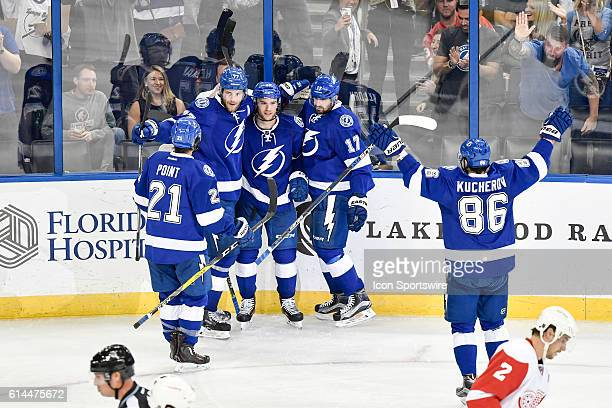 Tampa Bay Lightning left wing Jonathan Drouin celebrates his goal with teammates during an National Hockey League game between the Tampa Bay...