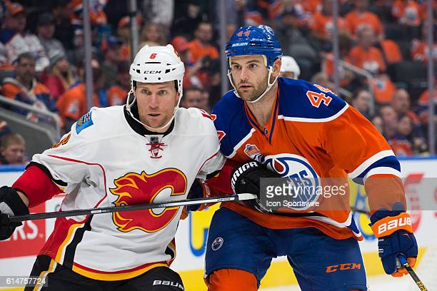 Zack Kassian of the Edmonton Oilers battles Dennis Wideman of the Calgary Flames during the Calgary Flames versus the Edmonton Oilers hockey game in...
