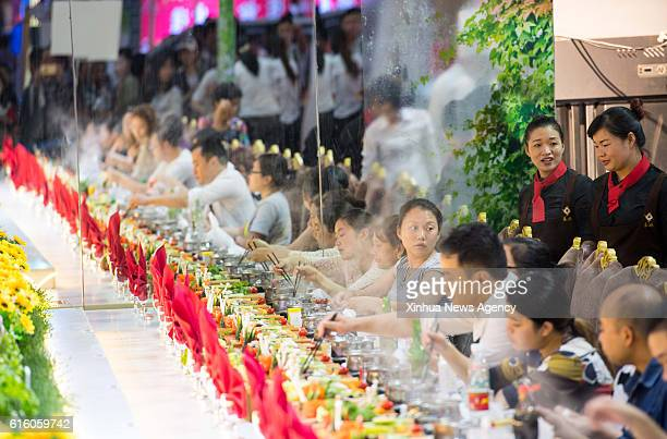 CHONGQING Oct 21 2016 Diners eat hot pots at the 8th China Hot Pot and Food Culture Festival in southwest China's Chongqing Oct 20 2016 Chongqing is...