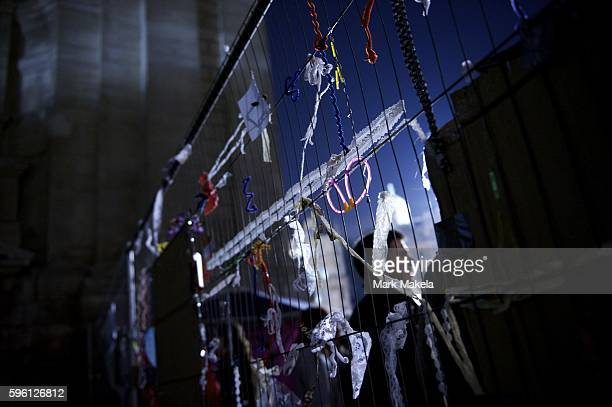 Oct 22 2011 London England UK Shreds of paper and balloons remain on a wall in the protestors camp of hundreds outside St Paul's Cathedral as part of...