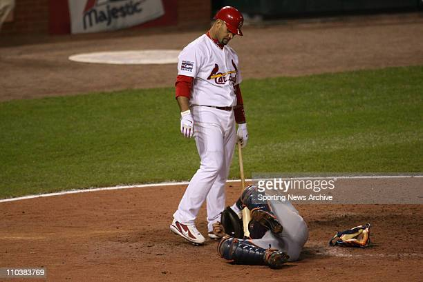 Oct 24 2006 St Louis MO USA The St Louis Cardinals against the Detroit Tigers catcher IVAN RODRIGUEZ rolls on the ground after being hit by a foul...