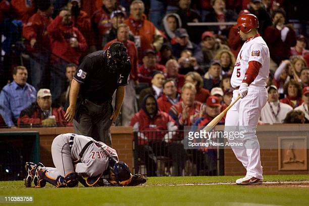 Oct 24 2006 St Louis MO USA The St Louis Cardinals ALBERT PUJOLS against the Detroit Tigers IVAN RODRIGUEZ after being hit by a foul tip to the...