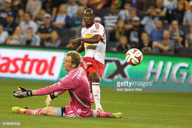 New York Red Bulls forward Bradley Wright-Phillips avoids Sporting KC goalkeeper Eric Kronberg to score his first goal of the match between the New...
